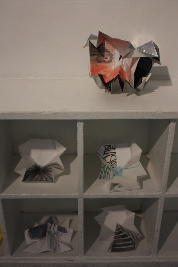 Annex with Chronicles of the Everything Vault (paper sculpture).